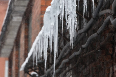 Snow And Ice On A Small Business Roof