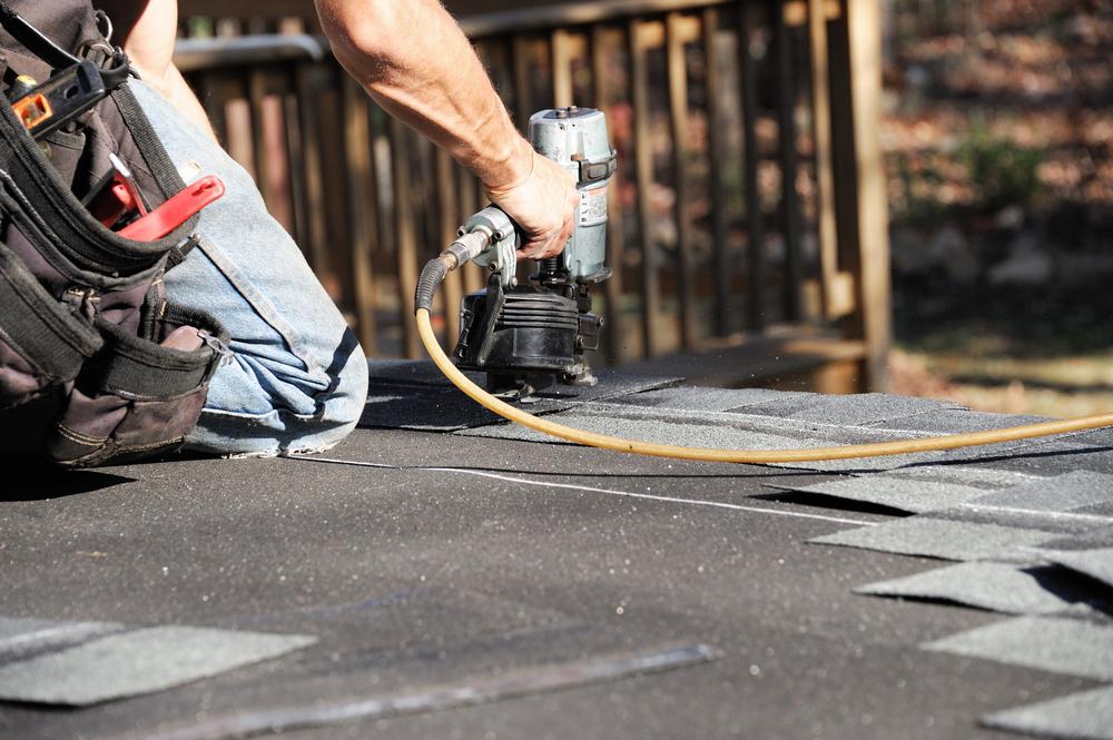 Restoration Technician Restoring Roof Shingles